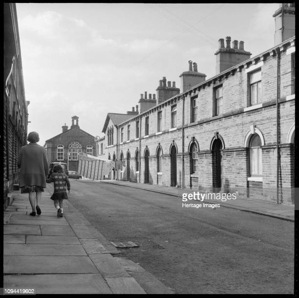 Shirley Street Saltaire Shipley Bradford West Yorkshire 19661974 A view looking west along Shirley Street with Saltaire Primary School on Albert Road...