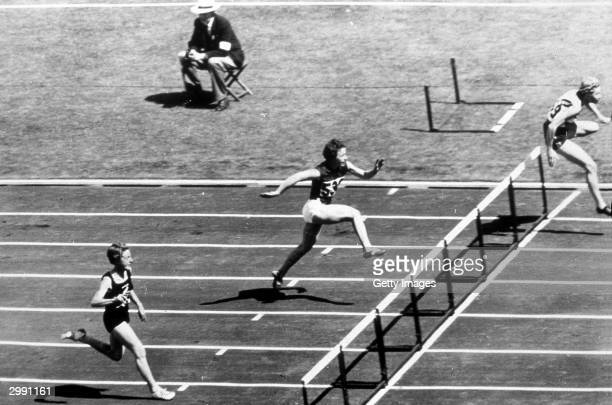 Shirley Strickland of Australia on her way to winning the Womens 80m Hurdles in a new Olympic record time of 108 seconds at the 1956 Melbourne...