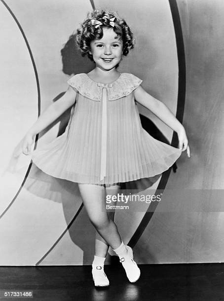 Shirley Temple as a child star wearing accordion pleated dress Undated photograph
