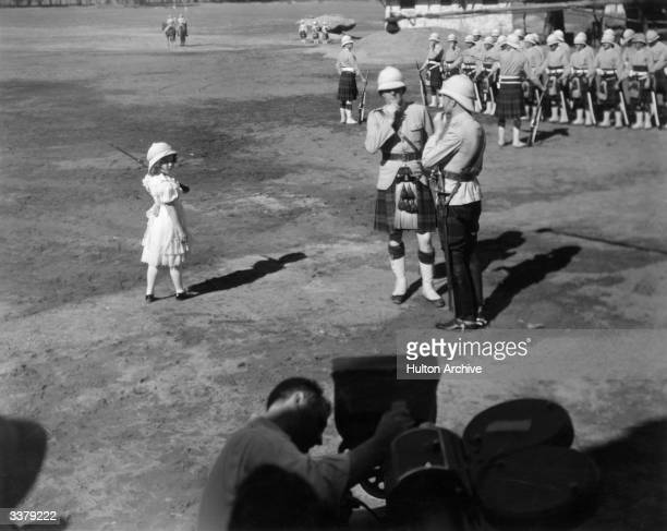 Shirley Temple as Priscilla Williams awaits the cry of 'action' during the production of 20th Century Fox's 'Wee Willie Winkie' directed by John Ford