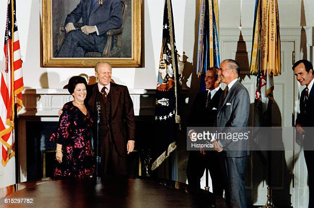 Shirley Temple Black and President Ford following her oath of office as Chief of Protocol for the State Department CIA director George Bush can be...