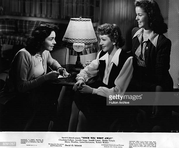 Shirley Temple Claudette Colbert and Jennifer Jones have a friendly conversation in a scene from 'Since You Went Away' directed by John Cromwell for...