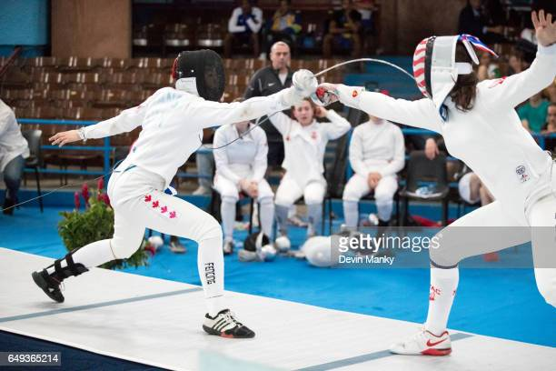 Shirley Wang of Canada fences against Team USA during competition in the gold medal match of the Junior Team Women's Epee competition at the Cadet...