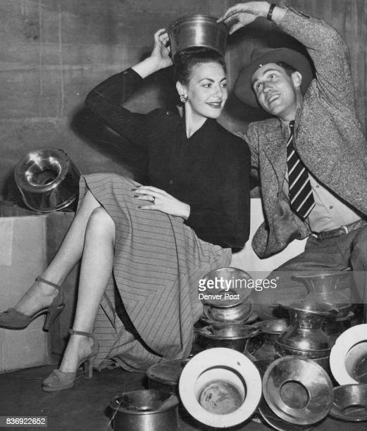 Shirley Zeronick tries on a burnished brass job for size as Stan Morgan gives the chapeau a smart tilt Shirley hopes to popularize the style and help...