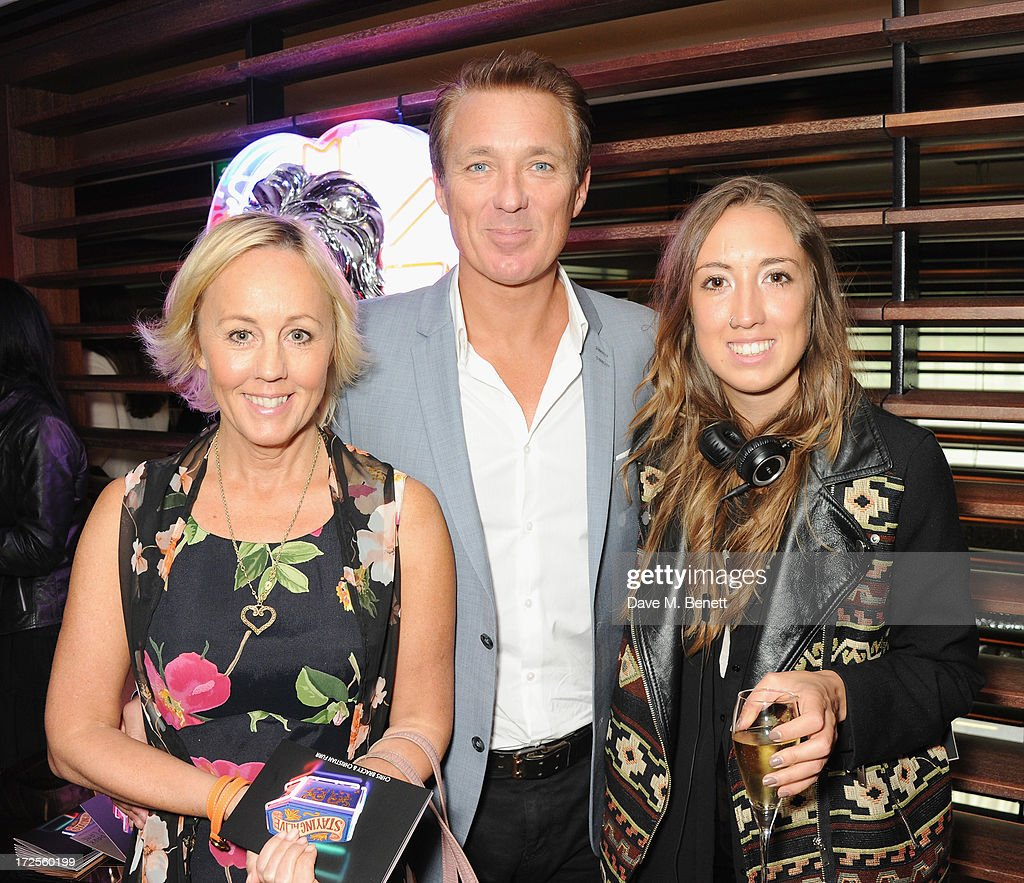 Shirley Holliman, Martin Kemp and Harley Moon Kemp attend Christian Furr and Chris Bracey 'Staying Alive' Private View at 45 Park Lane on July 3, 2013 in London, England.