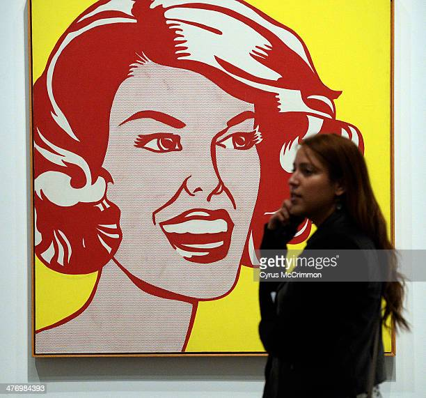 Shirly Pezo of Washington DC walks past the Roy Lichtenstein's painting 'Head Red and Yellow' at the Denver Art Museum's new exhibition 'Modern...