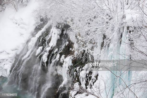 shirogane waterfall in winter, biei, hokkaido, japan - biei town stock pictures, royalty-free photos & images