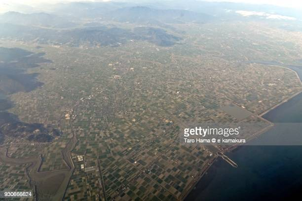shiroishi town in saga prefecture in japan daytime aerial view from airplane - 佐賀県 ストックフォトと画像