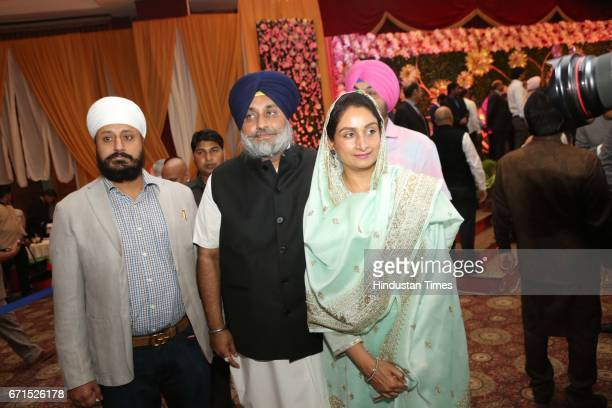 Shiromani Akali Dal Chief Sukhbir Singh Badal and Union Food Processing Industry Minister Harsmit Kaur Badal during the wedding reception of INLD MP...