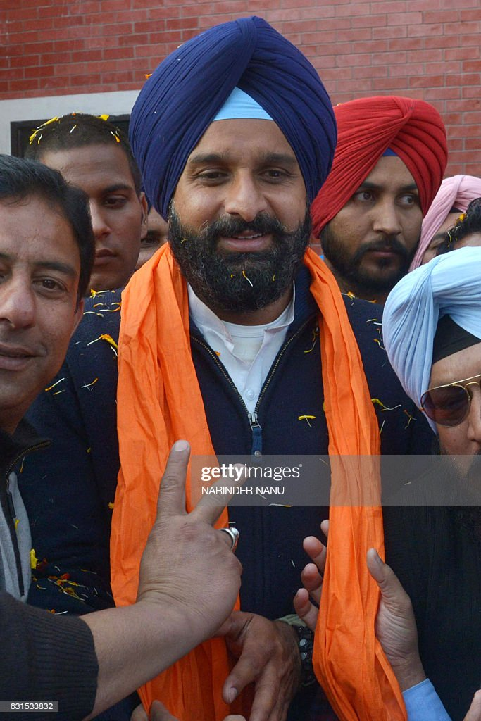 Shiromani Akali Dal party candidate for the Member of Legislative Assembly from Majitha Bikram Singh Majithia smiles after filing his nomination...