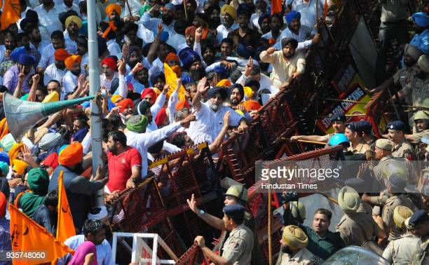Shiromani Akali Dal President Sukhbir Singh Badal along with other leaders and supporters marching towards Punjab Vidhan Sabha during the protest...