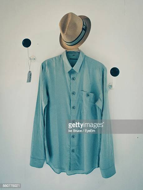 Shirt And Hat With Label Hanging On Hooks