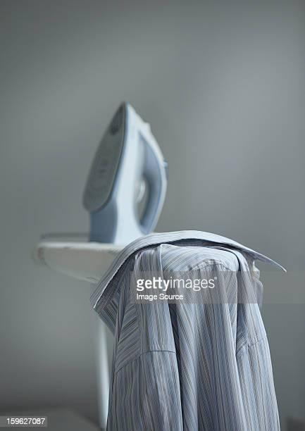 Shirt and iron on ironing board