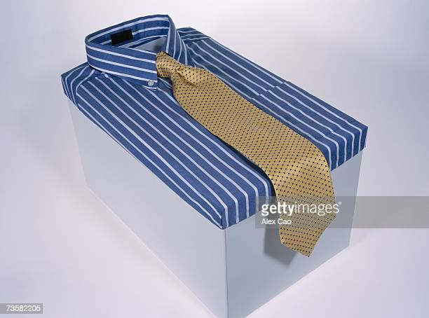 Shirt and tie folded on box