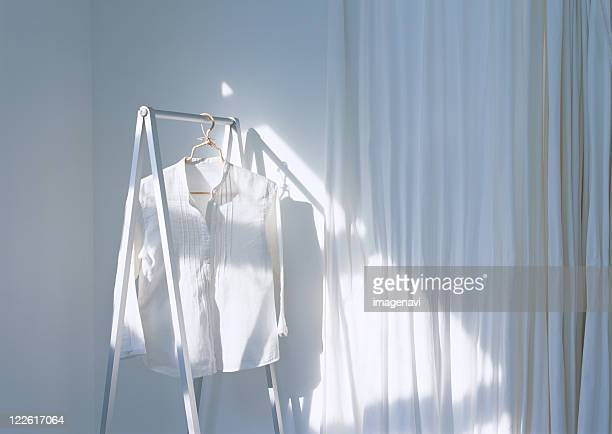 a shirt on the hanger - blouse stock pictures, royalty-free photos & images