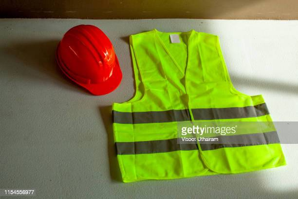 shirt with a safety helmet for construction department. - waistcoat stock pictures, royalty-free photos & images