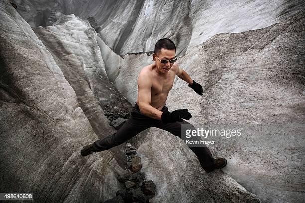 A shirtless Chinese tourist walks in the tongue of Glacier 1 at the base of the 7556 m Mount Gongga known in Tibetan as Minya Konka on November 10...
