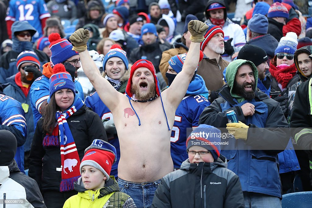A shirtless fan cheers during the first half of the game between the Buffalo Bills and the Cleveland Browns at New Era Field on December 18, 2016 in Orchard Park, New York.