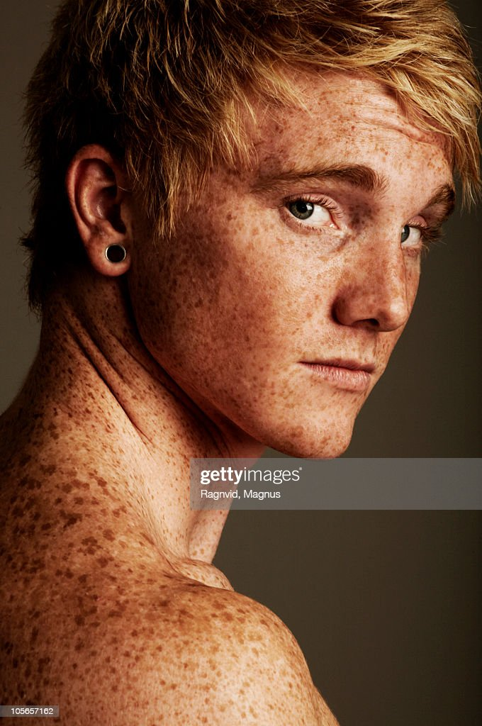 Shirtless freckled man, looking at camera : Stock Photo