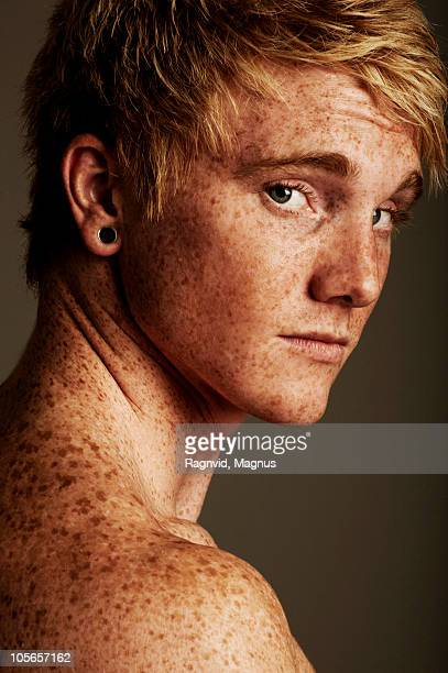 Shirtless freckled man, looking at camera