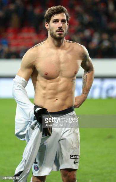 Shirtless goalkeeper of PSG Kevin Trapp salutes the fans following the French League Cup match between Stade Rennais and Paris Saint Germain at...