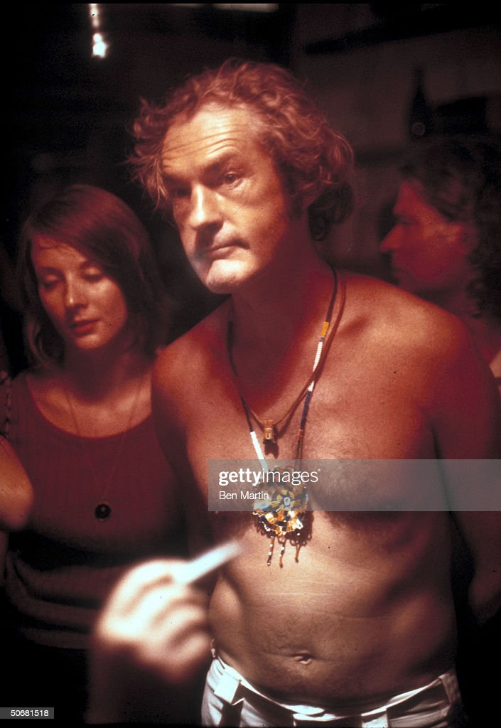 Shirtless LSD guru Timothy Leary wearing necklace & medallion at unident. event.