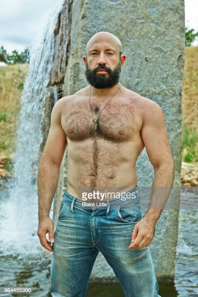 Shirtless Man by Waterfall