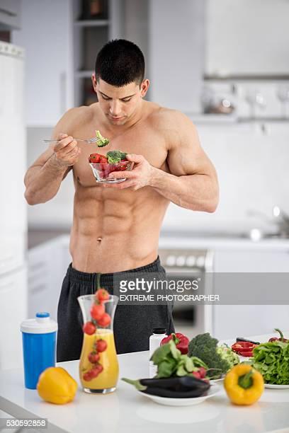 Shirtless man in the kitchen