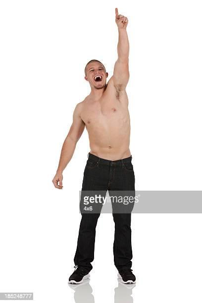 Shirtless man shouting in excitement