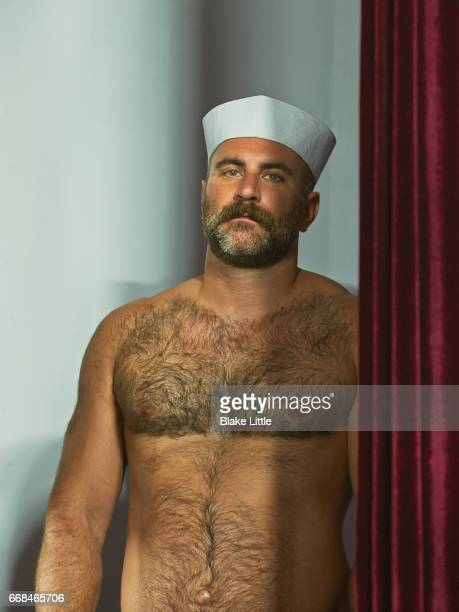 shirtless man wearing sailor hat