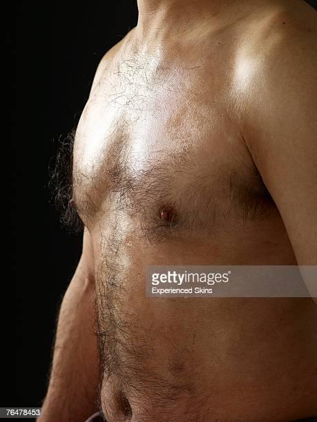 shirtless man with hairy chest, side view - hairy man chest stock pictures, royalty-free photos & images