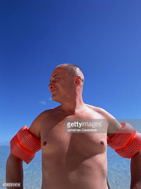 shirtless man with water wings - armband stock pictures, royalty-free photos & images