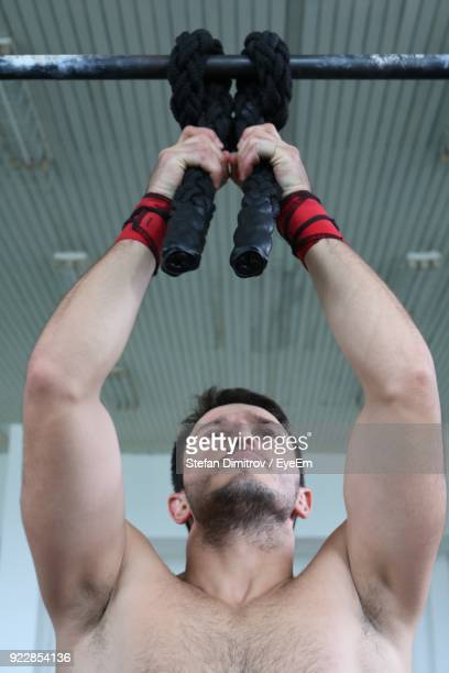 Shirtless Muscular Man Exercising In Gym