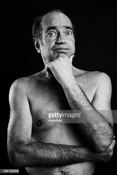 shirtless senior man posing on black background - old nudists stock pictures, royalty-free photos & images