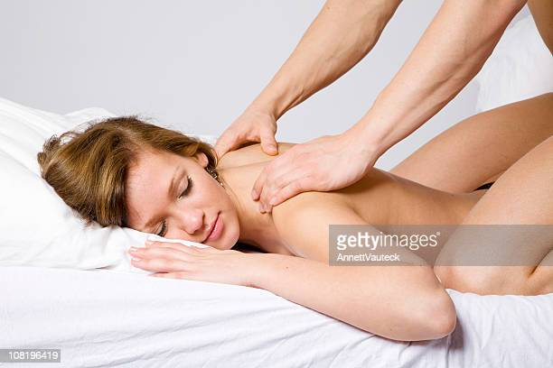 Shirtless Woman Receiving Back Massage from Man