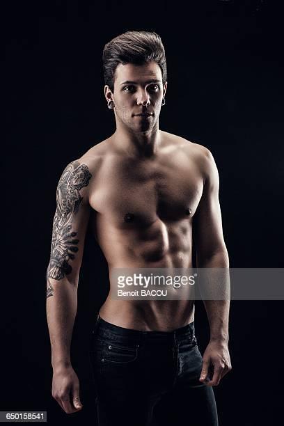 Shirtless young man, face, eyes toward the camera