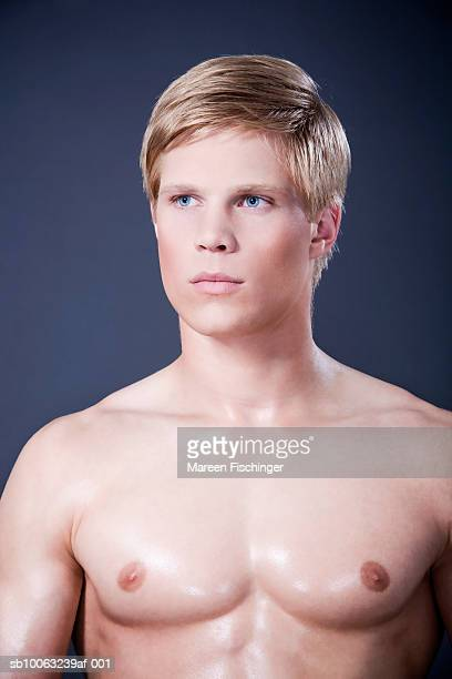 Shirtless young man looking away
