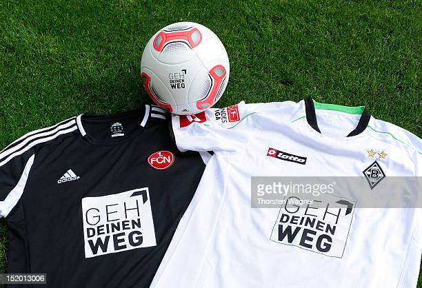 Shirts and the playball with special brands are pictured prior to the Bundesliga match between Borussia Moenchengladbach and 1FC Nuernberg at...