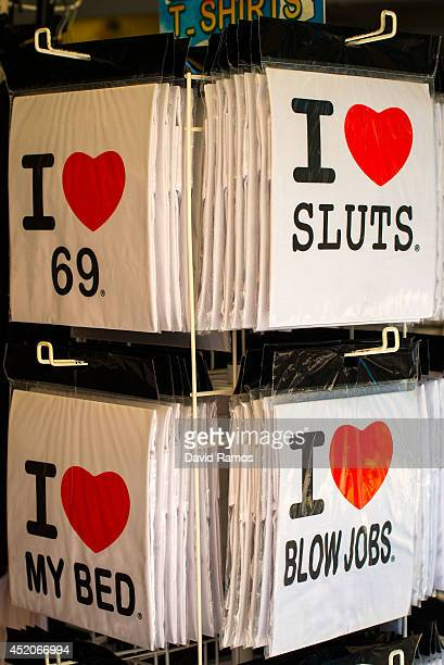 Shirts are seen on display at a Souvenir store at Magaluf beach on July 12 2014 in Mallorca Spain Magaluf is one of the Britain's favorite holiday...