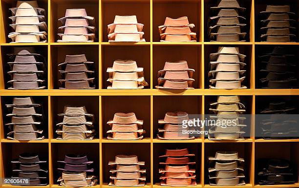 Shirts are seen stacked on shelves at a Hugo Boss AG shop in Rosenheim Germany on Friday Oct 30 2009 Hugo Boss AG's thirdquarter net income fell 25...