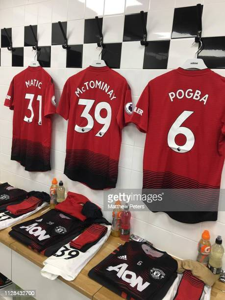 Shirts belonging to Nemanja Matic Scott McTominay and Paul Pogba of Manchester United hang in the away dressing room ahead of the Premier League...