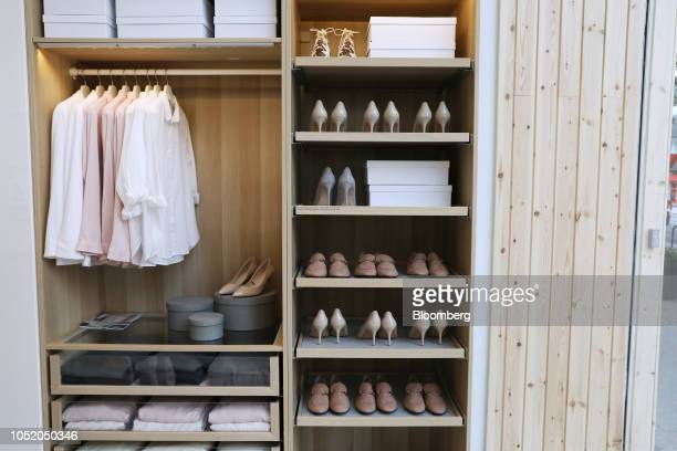 Shirts hang alongside shoes in a wardrobe display at an IKEA store in central London UK on Friday Oct 12 2018 Ingka Group the largest IKEA franchisee...