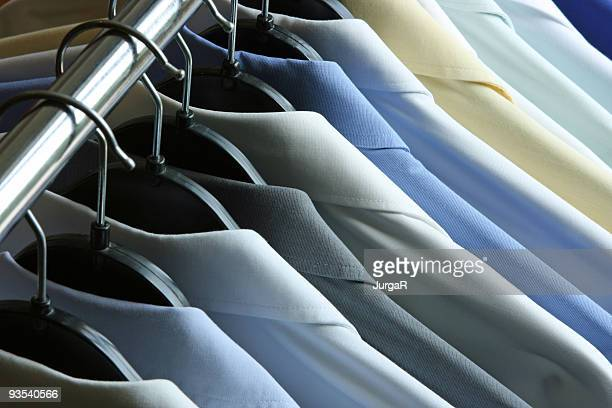 Shirts hanging on the rack - dry cleaner or laundry