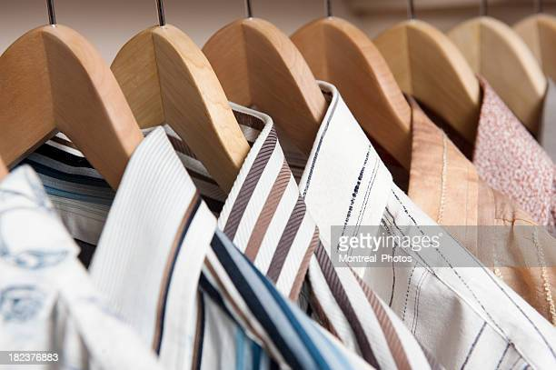 shirts hanging on wooden coat hangers - dry cleaned stock pictures, royalty-free photos & images