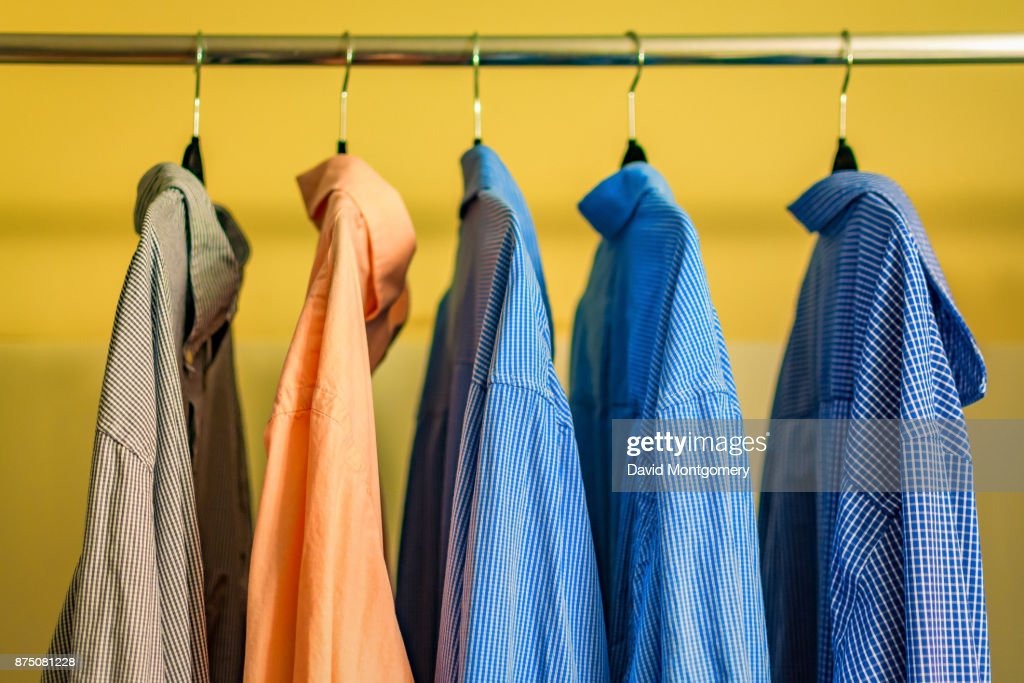 Shirts hanging up in a closet : Stock Photo