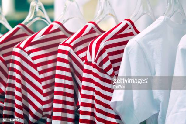shirts hanging with hanger - striped shirt stock pictures, royalty-free photos & images