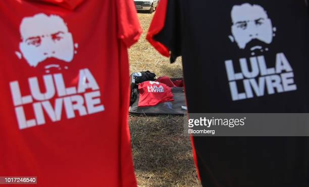 Dilma Rousseff Brazil's former president center speaks to a crowd of demonstrators at the Free Lula March in front of the Electoral Supreme Court in...