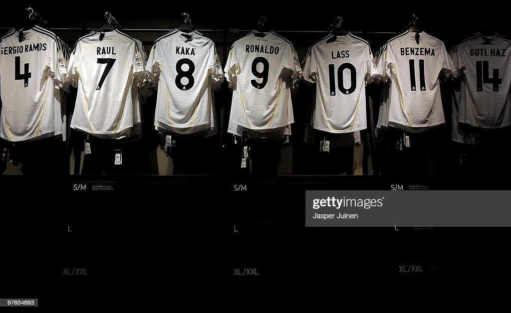 Shirts of Real Madrid star players hang inside the fanshop on the day after Real Madrid's UEFA Champions League aggregate defeat against Lyon at the Estadio Santiago Bernabeu on March 11, 2010 in Madrid, Spain.