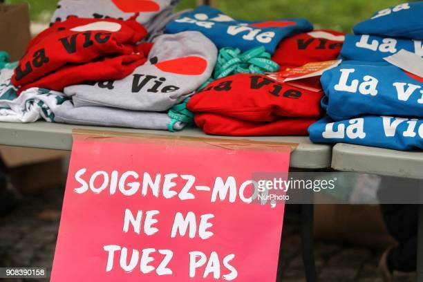 Shirts reading Marche pour la Vie and a sign reading Cure me dont kill me are seen in Paris on January 21 during a March for life demonstration...