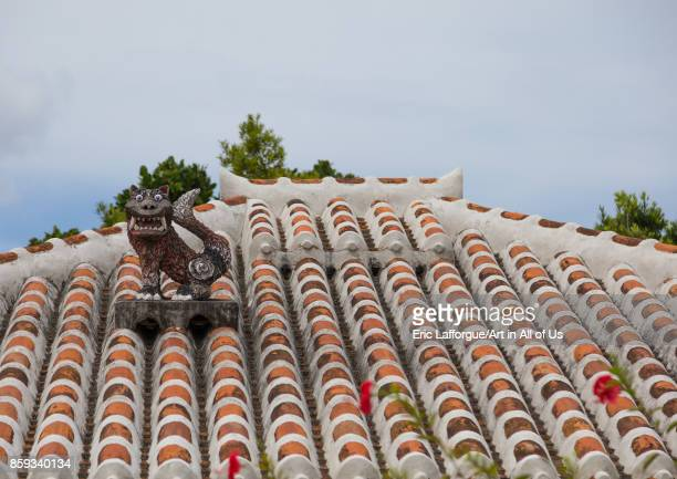 Shisa lion atop traditional tile roof to protect the house from the bad spirits Yaeyama Islands Taketomi island Japan on September 1 2017 in Taketomi...